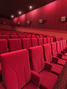 Cinema stage seats d render close up sound system spectacular lighting upholstered in red fabric Stock Image