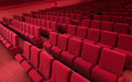 Cinema stage seats d render sound system spectacular lighting upholstered in red fabric Royalty Free Stock Images