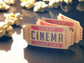 Cinema vintage entry ticket to the with popcorn around clipping path included Royalty Free Stock Photos