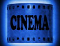 Cinema word on blue film strip background Royalty Free Stock Photography