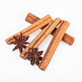 Cinnamon anise and cloves on white background sticks powder Royalty Free Stock Photography