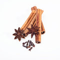 Cinnamon anise and cloves on white background sticks powder Royalty Free Stock Photos