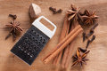 Cinnamon anise nutmeg cloves and grater on a wooden background Royalty Free Stock Photo