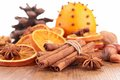 Cinnamon anise and orange on wood Royalty Free Stock Photo