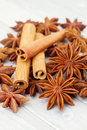 Cinnamon and anise sticks stars on wood background Stock Image