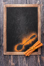 Cinnamon on black slate chalkboard. Menu board Stock Image