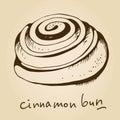 Cinnamon bun on beige background