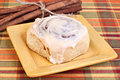 Cinnamon Bun and cinnamon sticks Royalty Free Stock Images