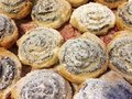 Cinnamon buns sprinkled with powdered sugar