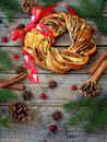 Cinnamon cocoa brown sugar wreath buns. Sweet Homemade christmas baking. Roll bread, spices, decoration on wooden background. New Royalty Free Stock Photo