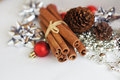 Cinnamon and cone red christmas ball Royalty Free Stock Photo