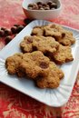 Cinnamon cookies with raisins homemade flower shaped whole wheat and hazelnuts Royalty Free Stock Photo