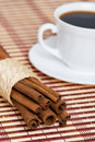 Cinnamon and cup of coffee Stock Images
