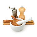 Cinnamon mill and mortar grinder on white background Stock Photo
