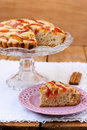 Cinnamon plum cake served on wooden table Royalty Free Stock Photos