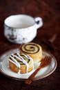 Cinnamon roll homemade pastry with cream cheese icing selective focus Stock Photo