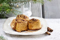 Cinnamon rolls on christmas eve table festive and party decoration Royalty Free Stock Photos