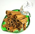 Cinnamon stick in a glass Stock Photos