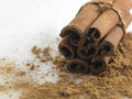 Cinnamon stick and powder on marble table Stock Images
