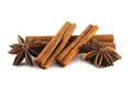 Cinnamon sticks and anise stars isolated on white background Stock Photos