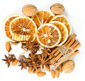 Cinnamon sticks, anise stars, nuts, dried orange Stock Photography