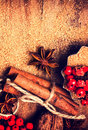 Cinnamon sticks brown sugar and anise star and on wooden table close up still life festive food background Stock Photos