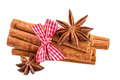 Cinnamon sticks bundle and anise over white.Traditional Christmas spices isolated on white Royalty Free Stock Photo