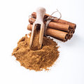 Cinnamon sticks and cinnamon powder on white background Royalty Free Stock Photos