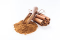 Cinnamon sticks and cinnamon powder on white background Stock Photo