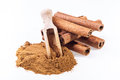 Cinnamon sticks and cinnamon powder on white background Stock Photos