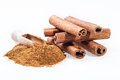 Cinnamon sticks and cinnamon powder on white background Royalty Free Stock Photo