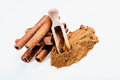 Cinnamon sticks and cinnamon powder on white background Royalty Free Stock Photography