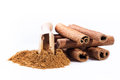 Cinnamon sticks and cinnamon powder on white background Royalty Free Stock Image