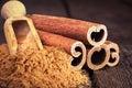 Cinnamon sticks and cinnamon powder Royalty Free Stock Photo