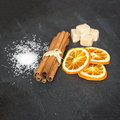 Cinnamon sticks with orange and sugar Stock Photo