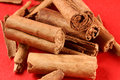 Cinnamon sticks over a red paper background Stock Photography