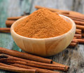 Cinnamon sticks and powder cinnamon Royalty Free Stock Photo