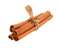 Cinnamon sticks with ribbon isolated on white Stock Photos
