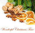 Cinnamon sticks star anise and pine brunch christmas decoration sliced of dried orange with sample text wonderful time Stock Photos
