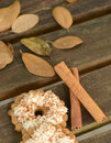 Cinnamon sticks and sweets cookies on wood table with autumn leaves Stock Image