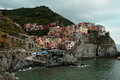 Cinque terre town of manarola the hillside sits perched high atop a hill along the coast Royalty Free Stock Image