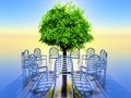 Circle a of chairs with a tree in the middle Royalty Free Stock Images
