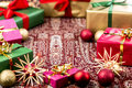 Circle of xmas gifts around central void circular arrangement plain christmas presents wrapped in green red magenta and gold depth Royalty Free Stock Images