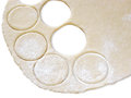 Circles cut from the test roll out dough and out of it Royalty Free Stock Image
