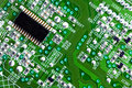 Circuit board and computer chip close up Royalty Free Stock Photo