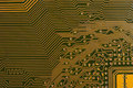 Circuit board digital highways close up photo of in gold and black Stock Images