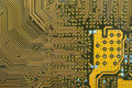 Circuit board digital highways close up photo of in gold and black Stock Photo