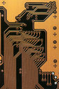 Circuit board digital highways close up photo of in gold and black Royalty Free Stock Images
