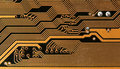 Circuit board digital highways close up photo of in gold and black Royalty Free Stock Photos