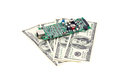 Circuit Board and dollars Royalty Free Stock Photo